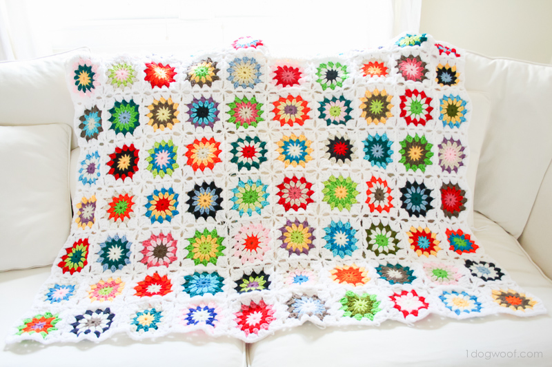 Colorful scrappy granny square quilt