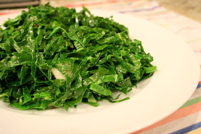 Stir fry collard greens by shredding them