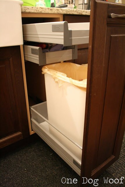 One Dog Woof: Ikea Hack. Attaching a bottom cabinet door to a drawer for a hidden garbage can.