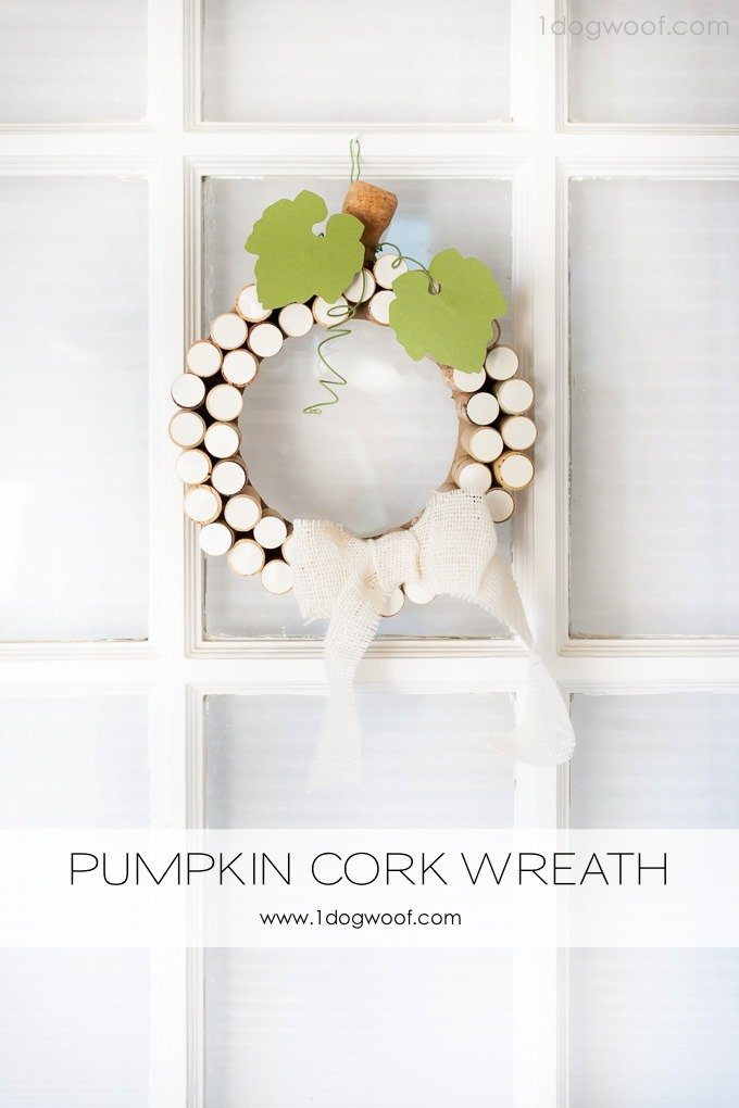 What an adorable pumpkin cork wreath that's perfect for fall.  Doesn't require a lot of corks and is easy to put together.  | www.1dogwoof.com