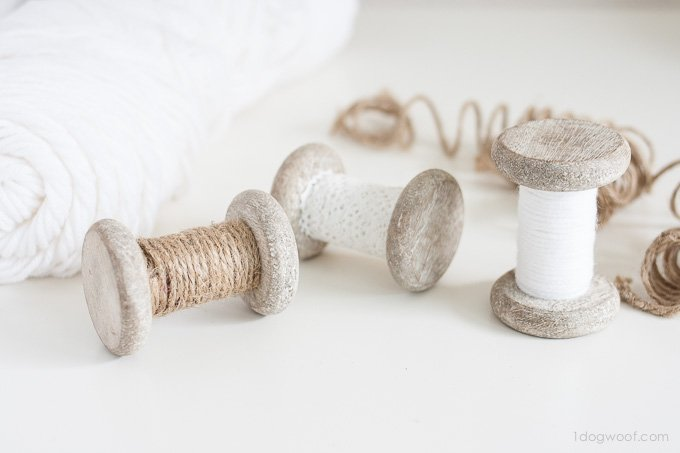 These spool ornaments are a great scrapbuster for extra twine, yarn or lace! | www.1dogwoof.com