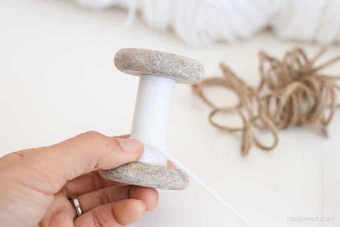 Super simple yarn-wrapped spool ornaments | www.1dogwoof.com