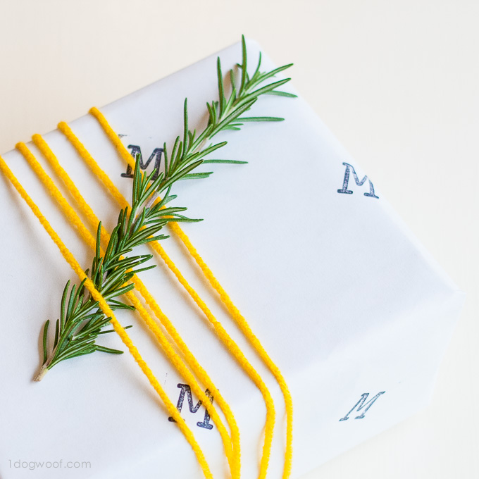 Use letter stamps to indicate recipient - personalized wrapper paper!   www.1dogwoof.com