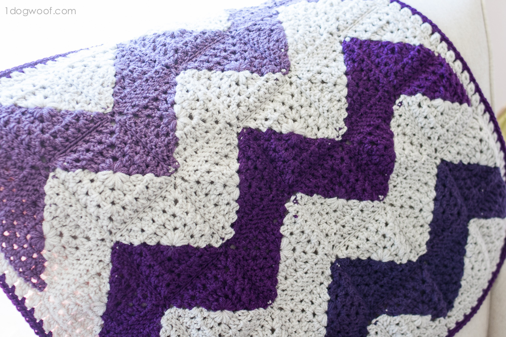 See how to make this unique chevron afghan using granny squares! | www.1dogwoof.com