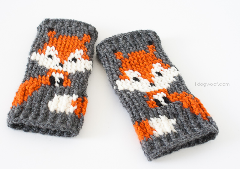 a pair of fox themed crochet fingerless gloves
