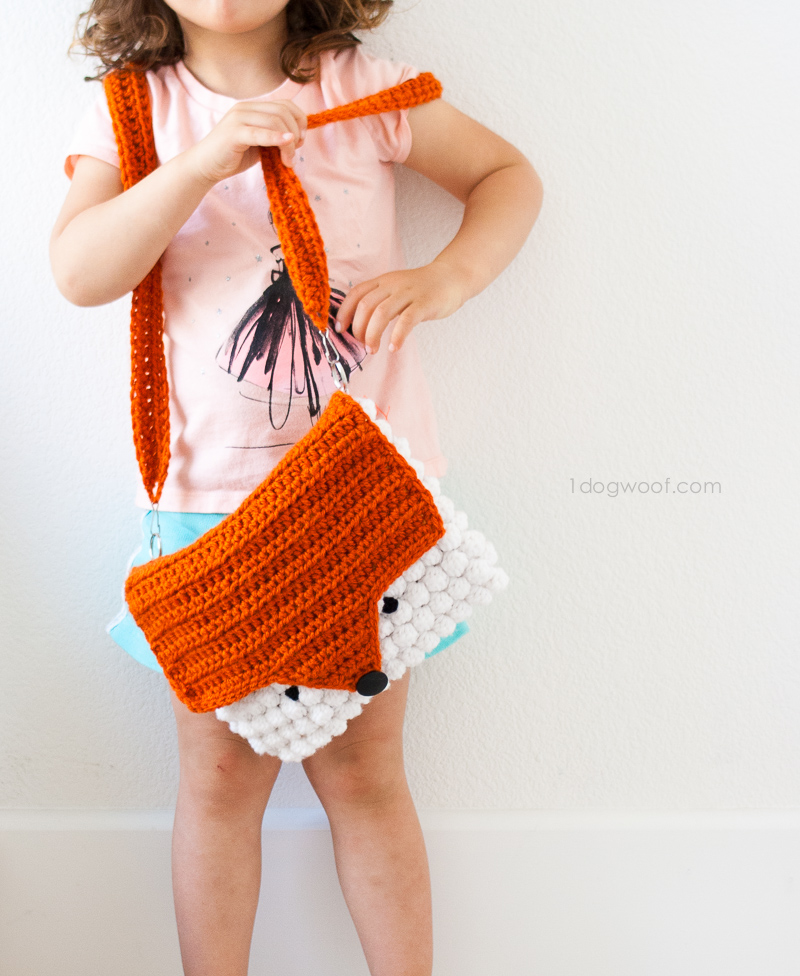 A fun and bright orange and white fox purse