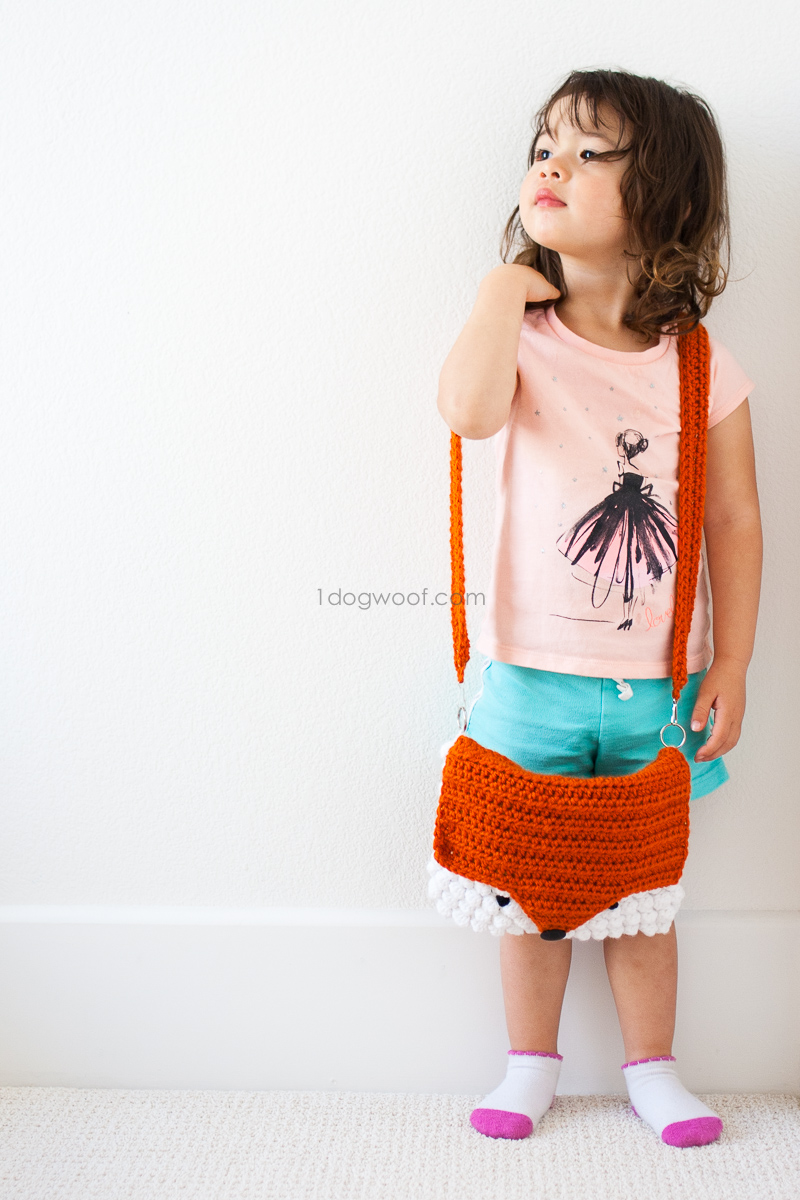 Feeling stylish rockin' her crochet fox purse. Free pattern available!