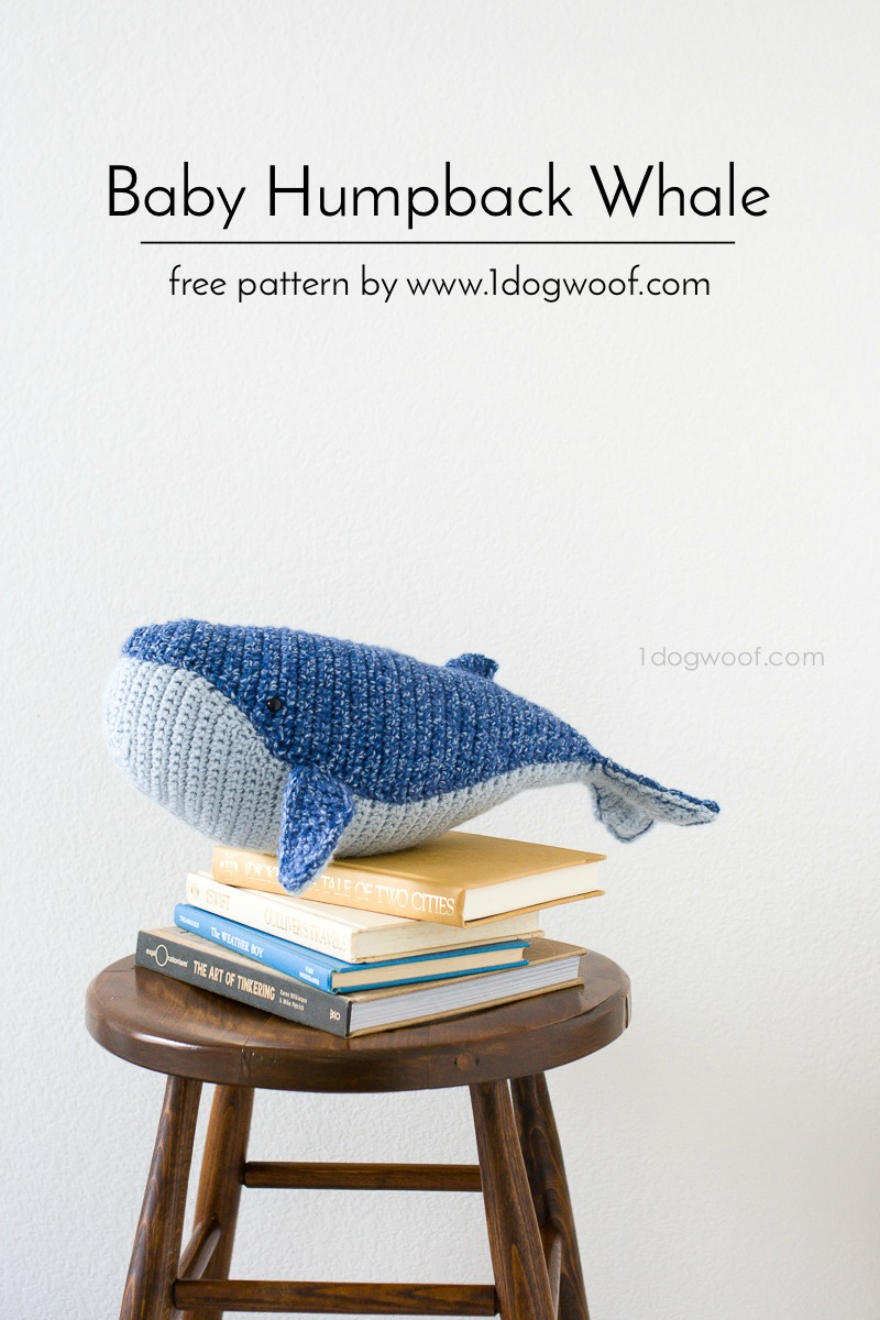 large stuffed whale sitting on stool