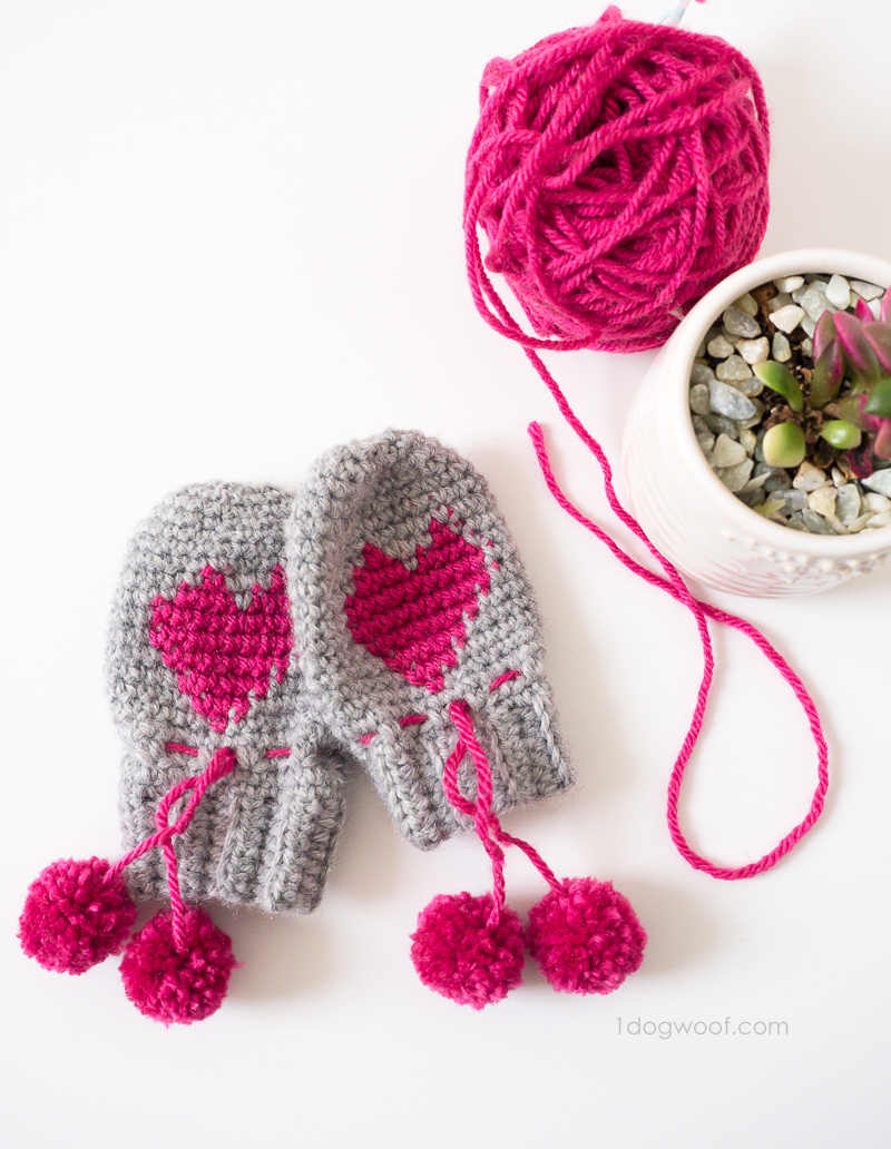 Adorable baby heart mittens with pom pom ties. | 1dogwoof.com
