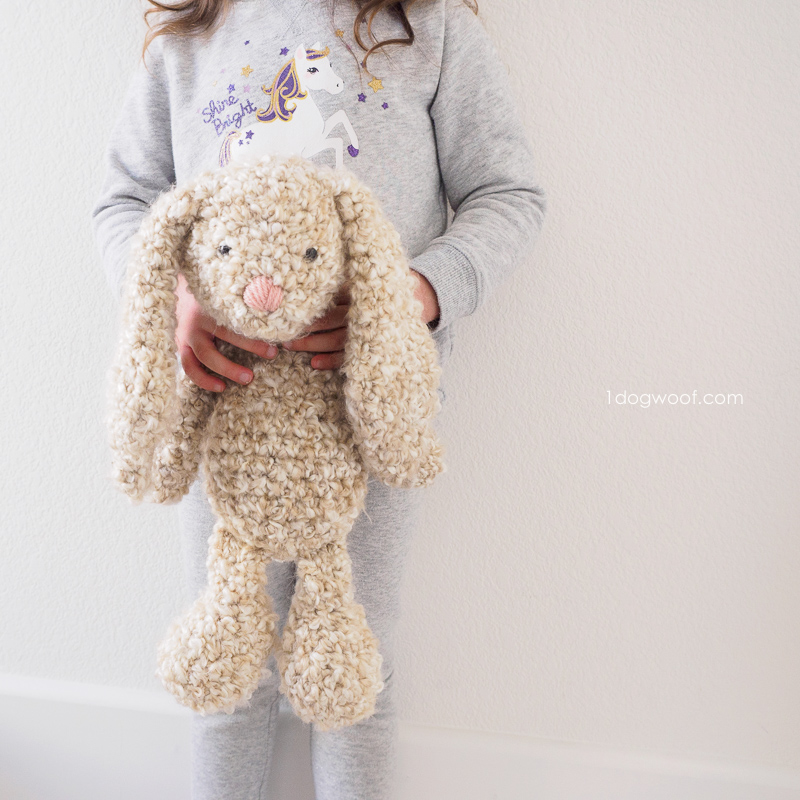 child holding crochet easter bunny