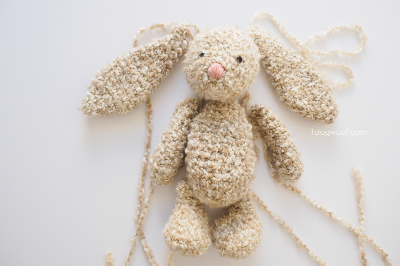 all the pieces of a cuddly crochet stuffed bunny