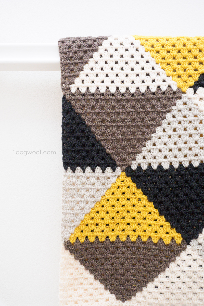 Simple geometric afghan using traditional granny stripes.