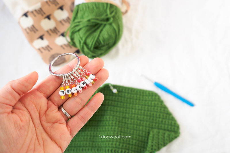 Holding diy crochet size markers in the palm of your hand