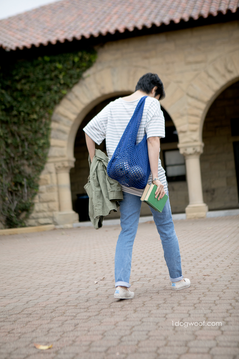 walking away carrying mesh bento bag