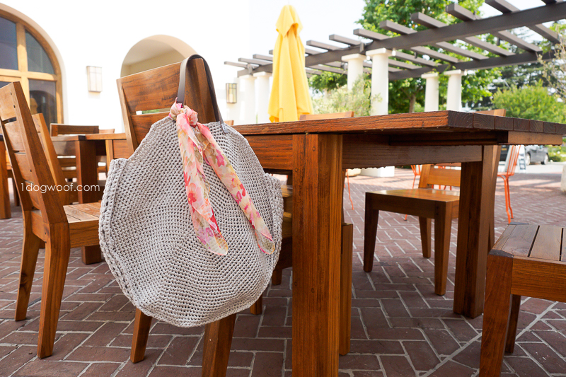 Sonoma circle bag at a table.