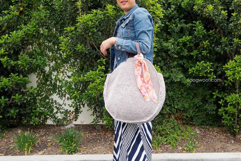Carrying a circle bag on your arm.