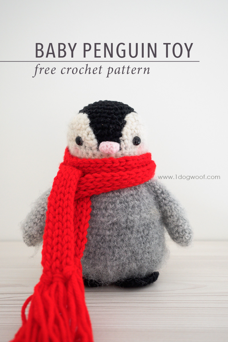 small fuzzy penguin with red scarf