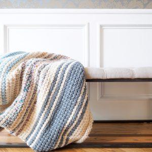 Daydream blanket falling off a bench