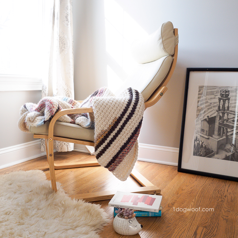 reading nook with sunset stripes blanket