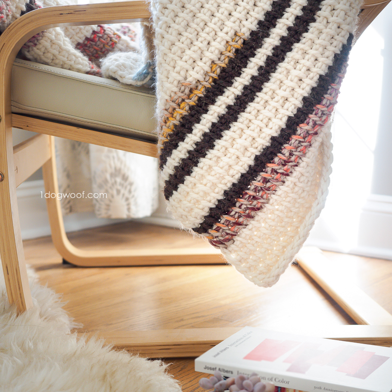 corner of tunisian crochet blanket, with book
