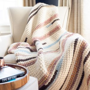 cozy tunisian crochet blanket on armchair