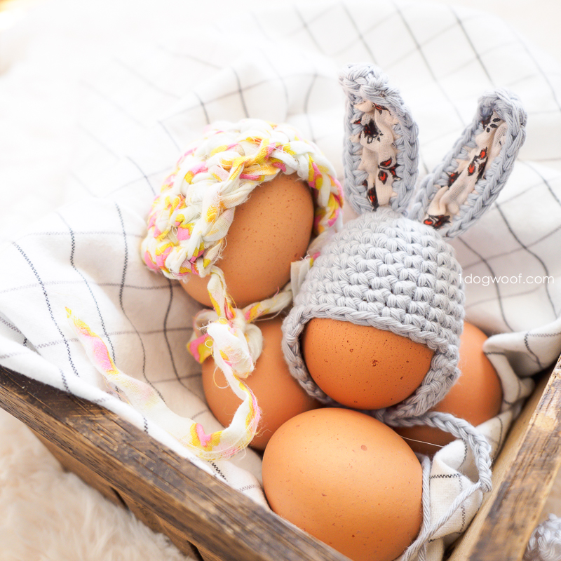 bunny hat and bonnet on eggs in basket