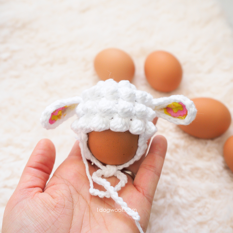 easter egg with lamb hat in palm