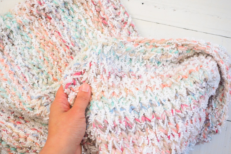 Hand showing squishiness of Snowcone Blanket