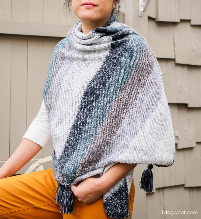 strata bias knit wrap thrown over shoulder