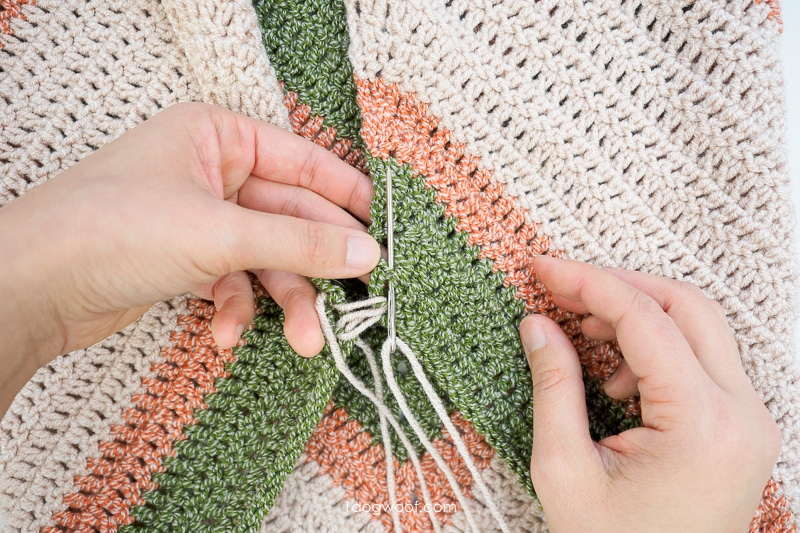 sewing up a stitch with mattress stitch
