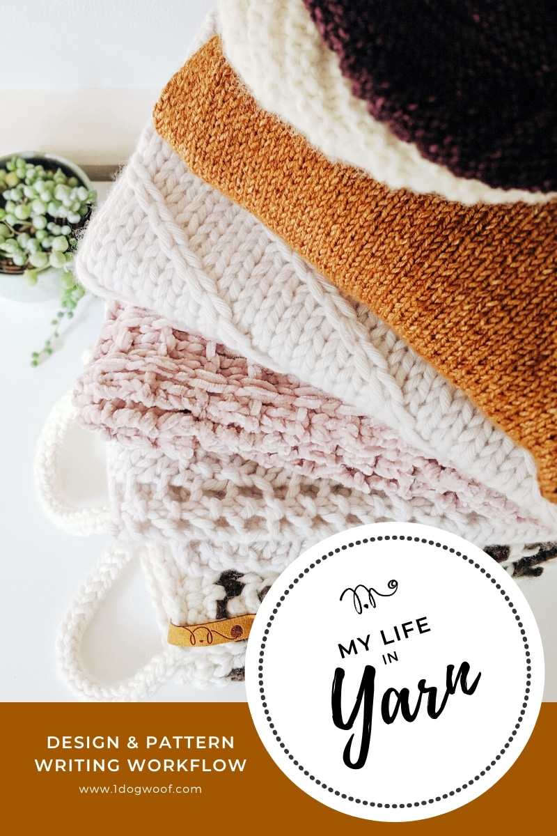stack of finished handknits and self-published patterns