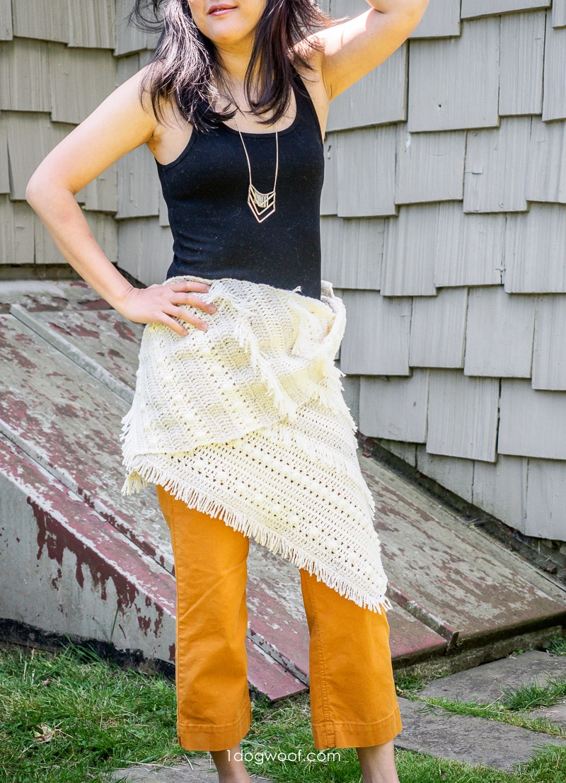boho style fringed crochet shawl worn as wrap around waist