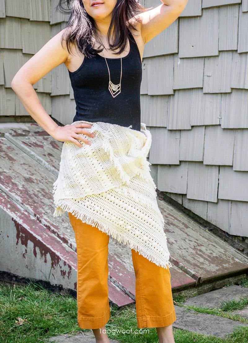 boho style fringed crochet shawl worn as wrap around waist