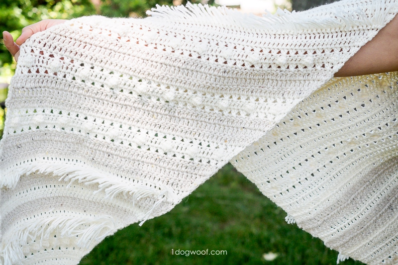 close-up of fringe, eyelets and bobbles in crochet shawl