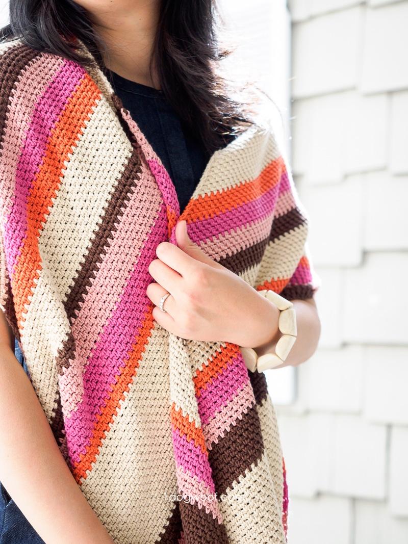 diagonal striped crochet shawl around shoulders