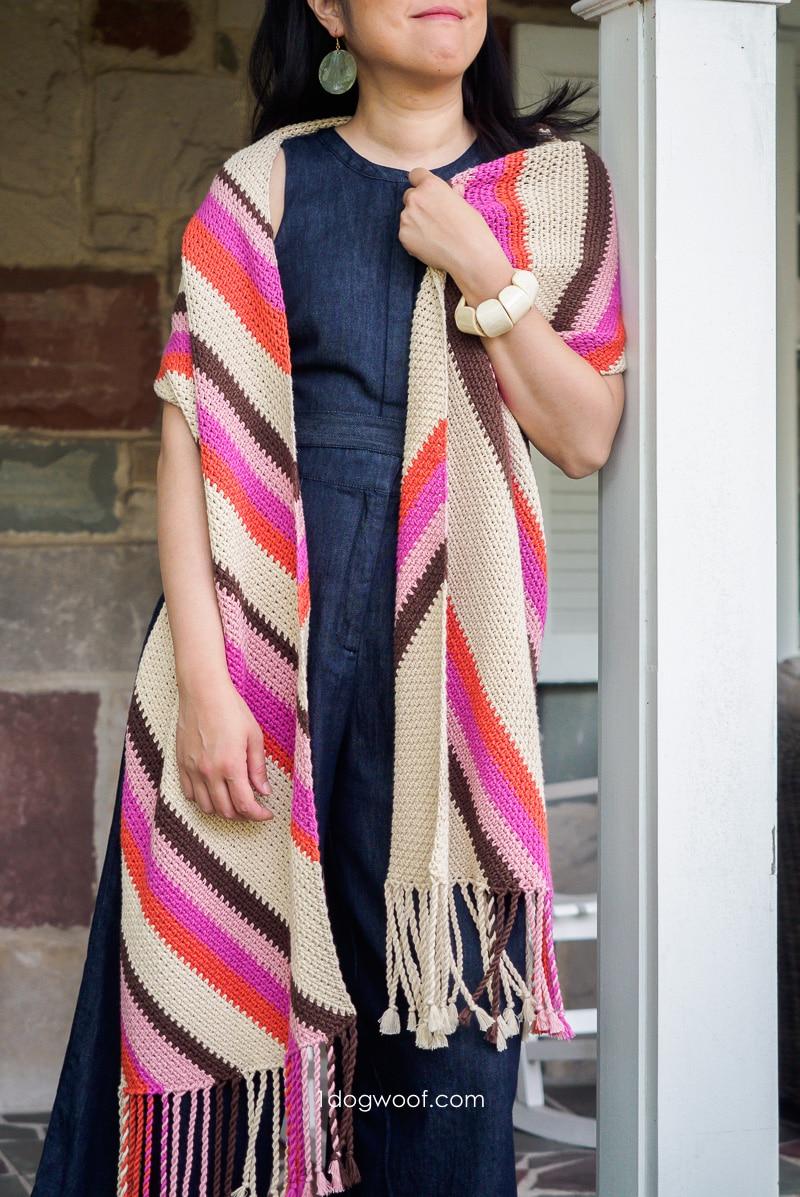 wearing throwback wrap leaning against pillar