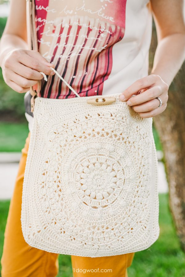 button tie closure on crochet bag