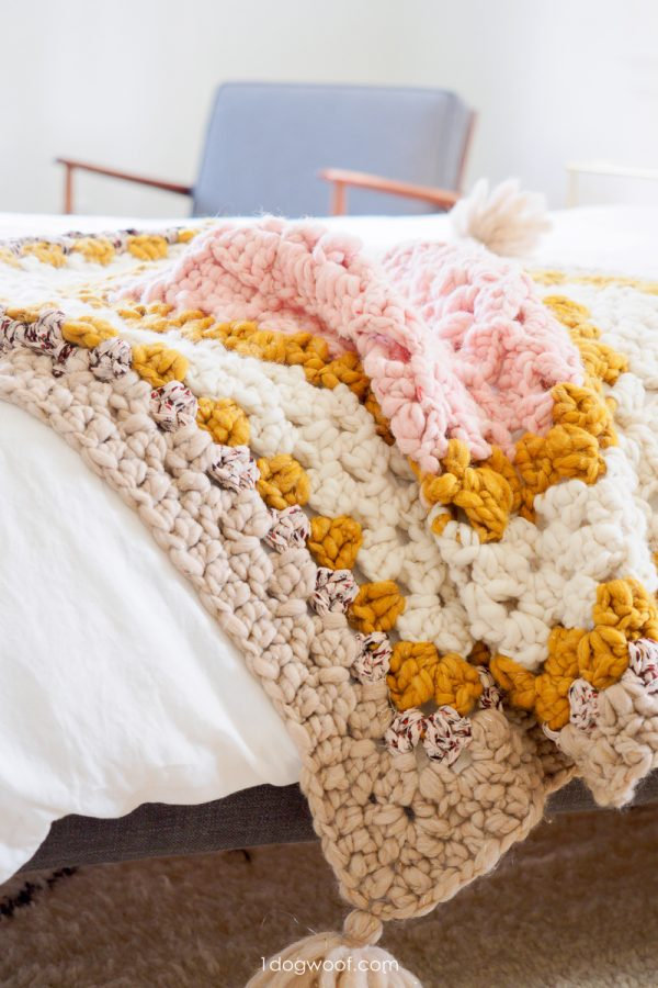 chunky granny square throw on bed