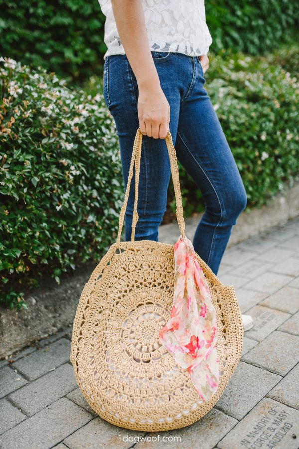 raffia crochet circle bag resting on ground