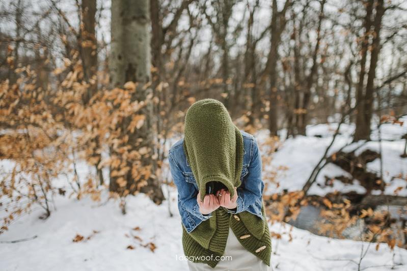 large knit hood on green vest under jean jacket