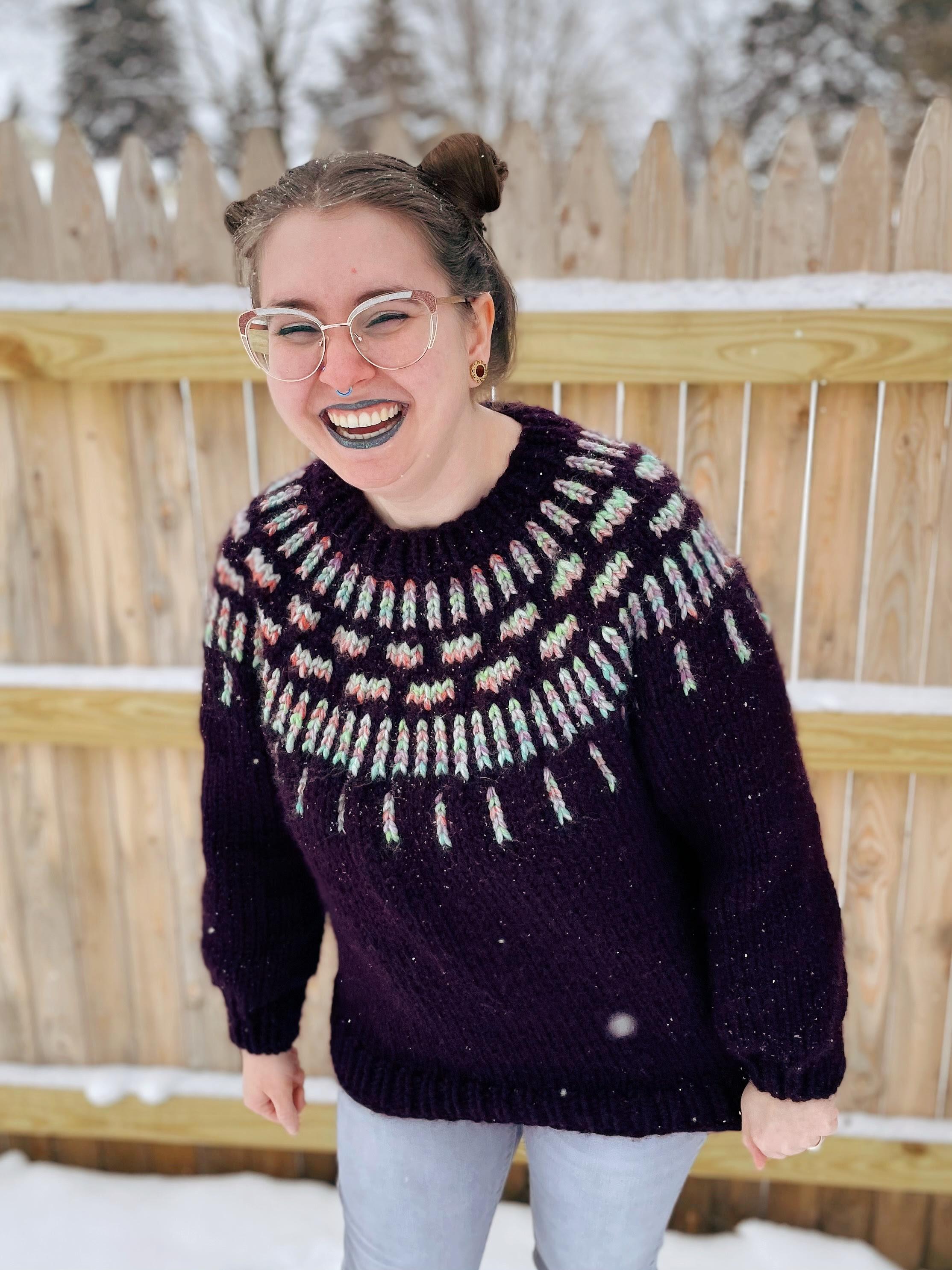 variegated yarn on dark sweater